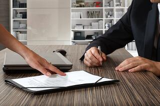 Estate planning documents being signed